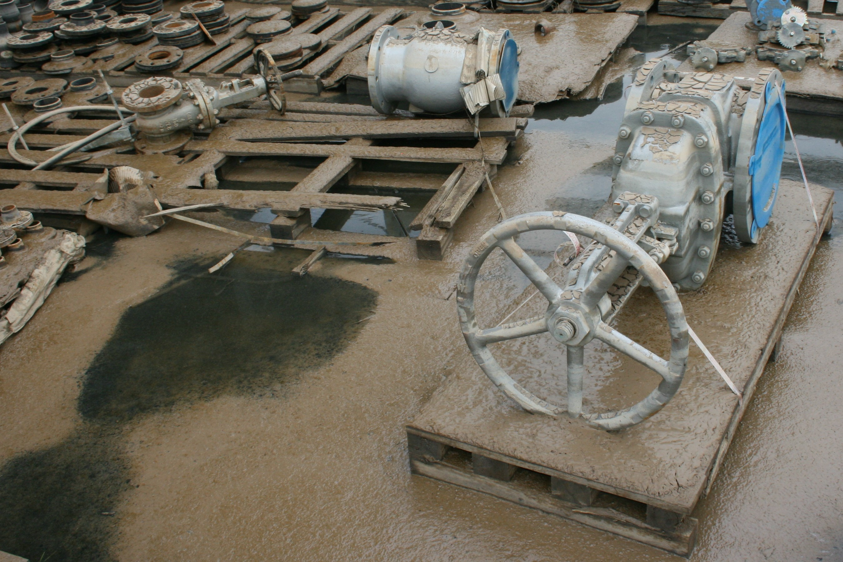 Valves and flanges in a lay-down area that flooded during a hurricane